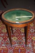Late 19th century satinwood veneered bijouterie table, the oval glazed top opening to a fabric lined
