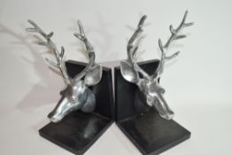 Pair of book ends both modelled with heads of stags in white metal