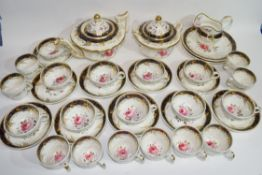19th century English porcelain tea set, possibly Derby, decorated to the interior with a blue border