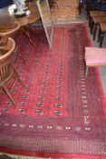 Large 20th century Bokhara type carpet with a large central panel decorated with medallions,