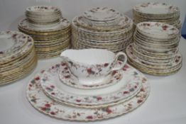 An extensive dinner service by Minton in the Ancestral pattern comprising several hundred pieces