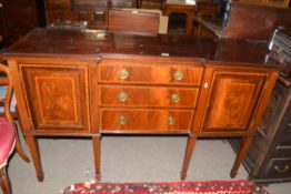 Edwardian mahogany sideboard with three drawers fitted with brass ringlet handles and two panelled