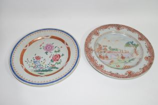 Two Chinese porcelain plates, one with European style decoration, the other with flowers (2)