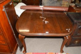Georgian style small mahogany extending dining table with extra leaf raised on cabriole legs,