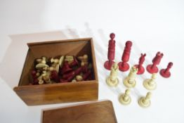 19th century ivory and red stained ivory part chess set, some breakages and losses throughout,
