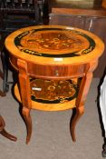 20th century oval marquetry inlaid two-tier table with frieze drawer, reputedly a gift from the
