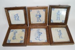 Set of six Dutch 18th century Delft tiles with various typical designs of figures, all in wooden