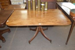 19th century mahogany pedestal dining table, the rectangular top over a turned column with quatre