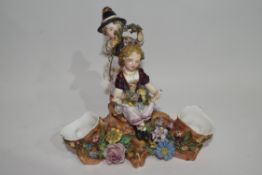 Porcelain spill holder group of boy and girl sitting on a tree stump by James Bevington, with