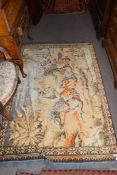 20th century Middle Eastern wool floor rug decorated with a scene of figures on horseback, 164 x