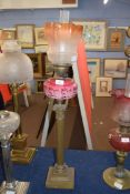 Victorian oil lamp with tinted frosted glass shade, clear glass chimney, opaque pink glass font with