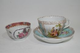 Continental porcelain cup and saucer decorated in Meissen style with panels of figures
