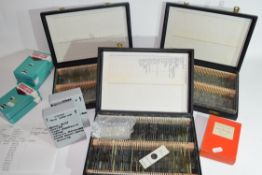 Collection of various microscope slides contained within three large black cases and eight various