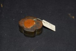 Small Chinese base metal box, probably antimony, of lobed form with pull off lid, 4cm wide, with