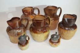 Group of 19th century harvest ware jugs by various manufacturers including Bailey, Fulham and Tom