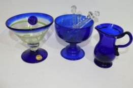 Quantity of blue glass wares, one with a spiral green design, Bristol Blue small jug, possibly