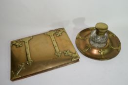 Victorian brass ink stand with clear glass bottle decorated with Gothic hinged type detail, together