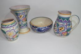 Quantity of Poole pottery wares including flared vase with geometric design, a bowl in the