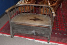 19th century elm seated small settle or hall chair with bow and stick back raised on shaped front