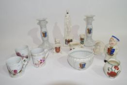 Group of crested wares, small jar for Great Yarmouth, pair of candlesticks also for Great