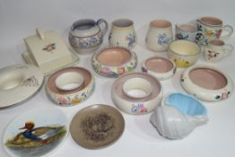 Group of Poole wares including cheese dish and cover, various Poole jugs with floral and geometric