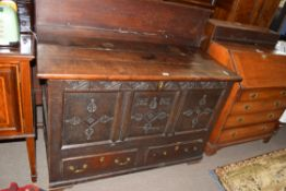 Large 18th century oak mule chest with three panelled front decorated with carved detail and