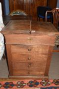 Late 19th century oak shop cabinet with fold-up lid opening to reveal an area containing mixing tub,