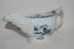 Large Lowestoft sauce boat circa 1765, the body crisply moulded with trailing flowers, bordering a