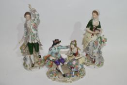 Group of Continental porcelain figurines including a gentleman and lady on oval base and two further