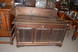 Large oak coffer with three panelled front and plank top, 135cm wide