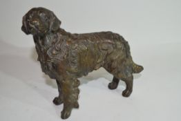 Late 19th/early 20th century bronzed metal model of a dog, 17cm high