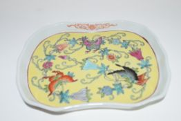 Small Chinese porcelain shaped dish, the yellow ground centre decorated with moss and butterflies,
