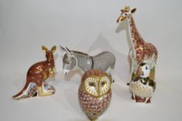 Quantity of Royal Crown Derby gold stopper paperweights including models of a donkey, giraffe,