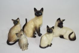 Group of ceramic models of cats by Beswick and others, mainly Siamese (qty)
