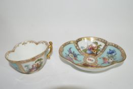 Continental porcelain Dresden cup and saucer of lobed shape decorated in Meissen style
