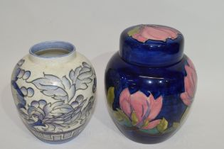 Moorcroft jar and cover, the blue ground with floral design