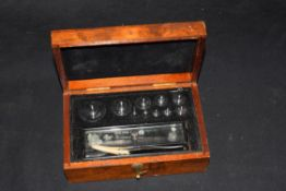 Cased set of chemists weights, the box bearing trade label for J Towers & Co Ltd, Manchester, Widnes