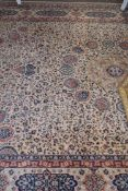 Wool carpet, beige coloured ground, blue and foliate pattern, gulled border, 12 x 9ft