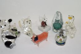 Collection of glass animal sculptures including a dog paperweight, a faceted glass duck and a