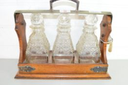 EARLY 20TH CENTURY OAK AND SILVER PLATED FRAMED TANTALUS