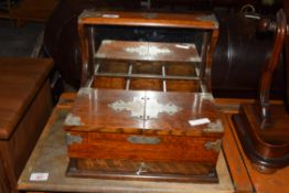 LATE 19TH/EARLY 20TH CENTURY OAK TANTALUS BOX WITH APPLIED METAL MOUNTS, LACKING BOTTLES, 33CM WIDE