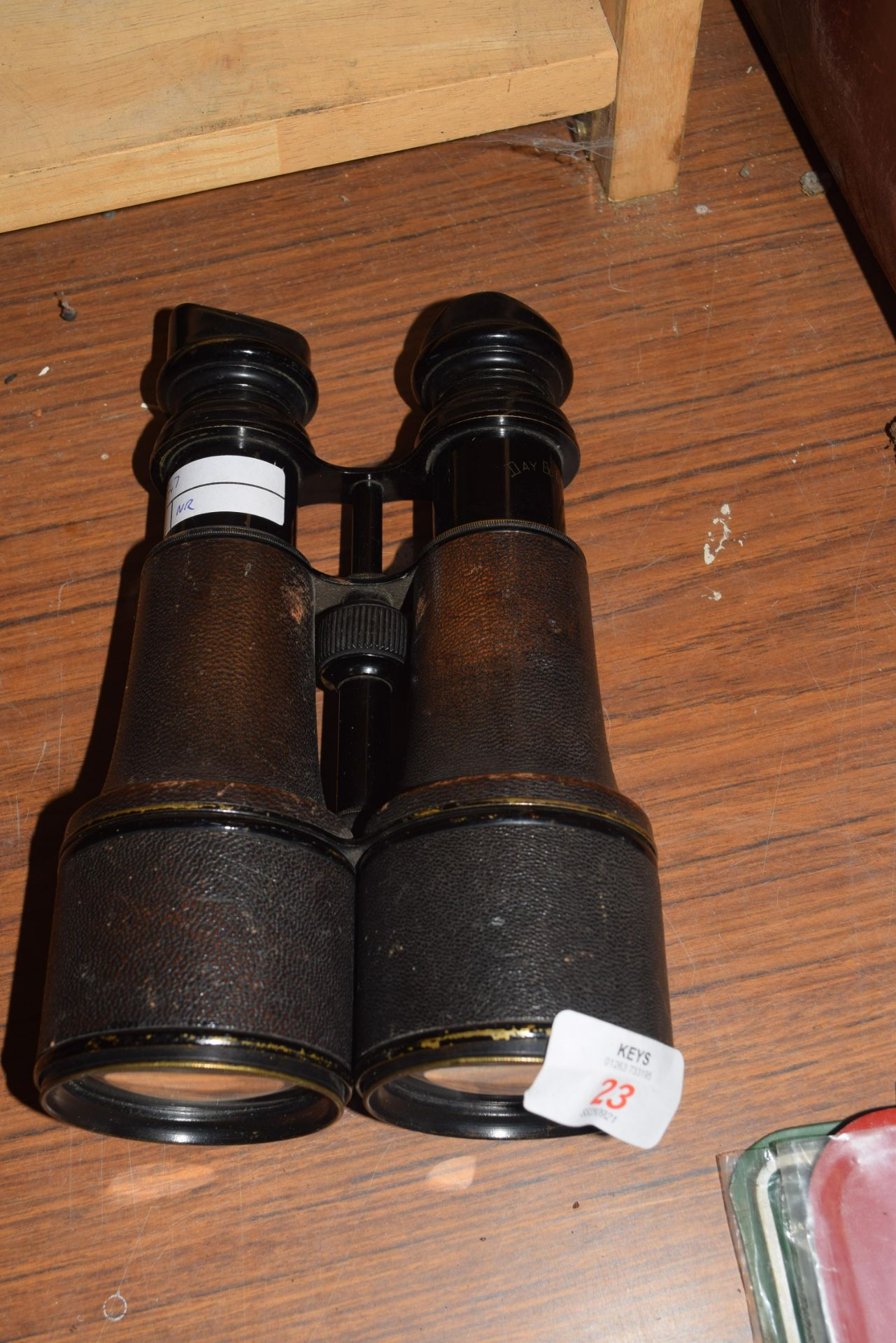 Antique day and night binoculars, marked Fournsseur dela Marine, 20cm high and a further pair of