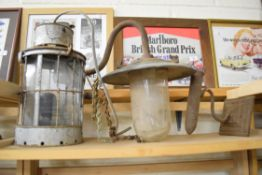 Vintage oil lamp along with another swan-necked external light fitting