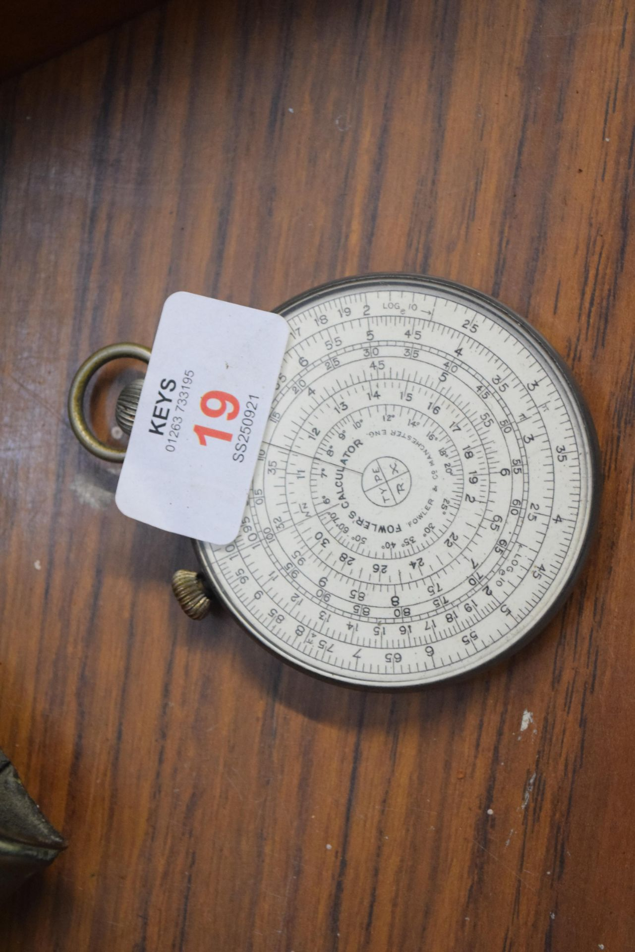 Mathematical interest - a Fowlers circular calculatore Type RX set in a base metal surround, 6.5cm