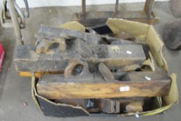 Box containing large wooden block planes