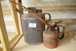 Two vintage oil cans