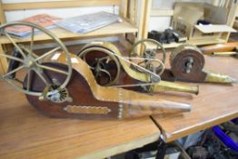 Collection of three 19th century brass or copper mounted mechanical fire bellows, bearing makers