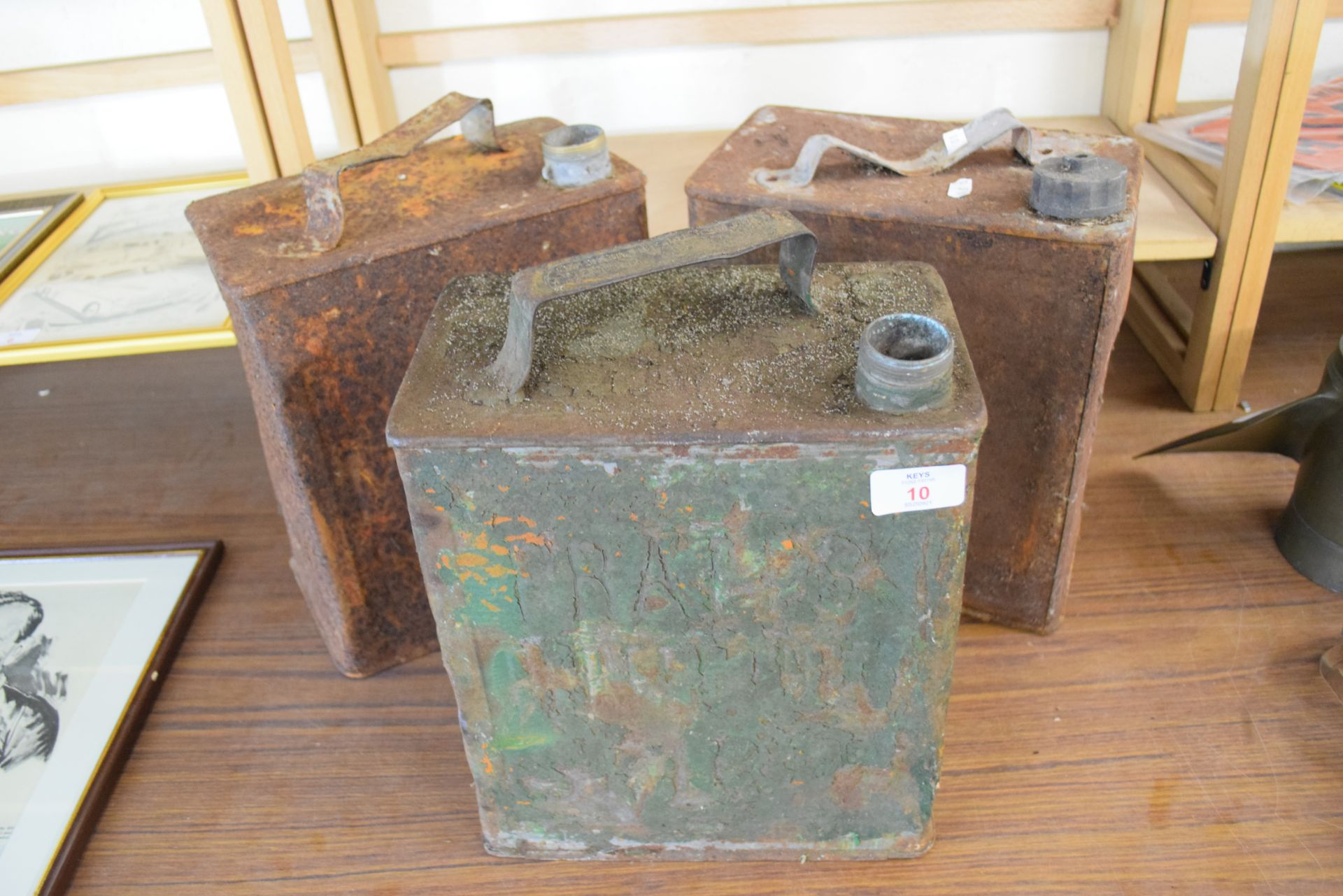 Three petrol cans, one marked Shell Motor Co