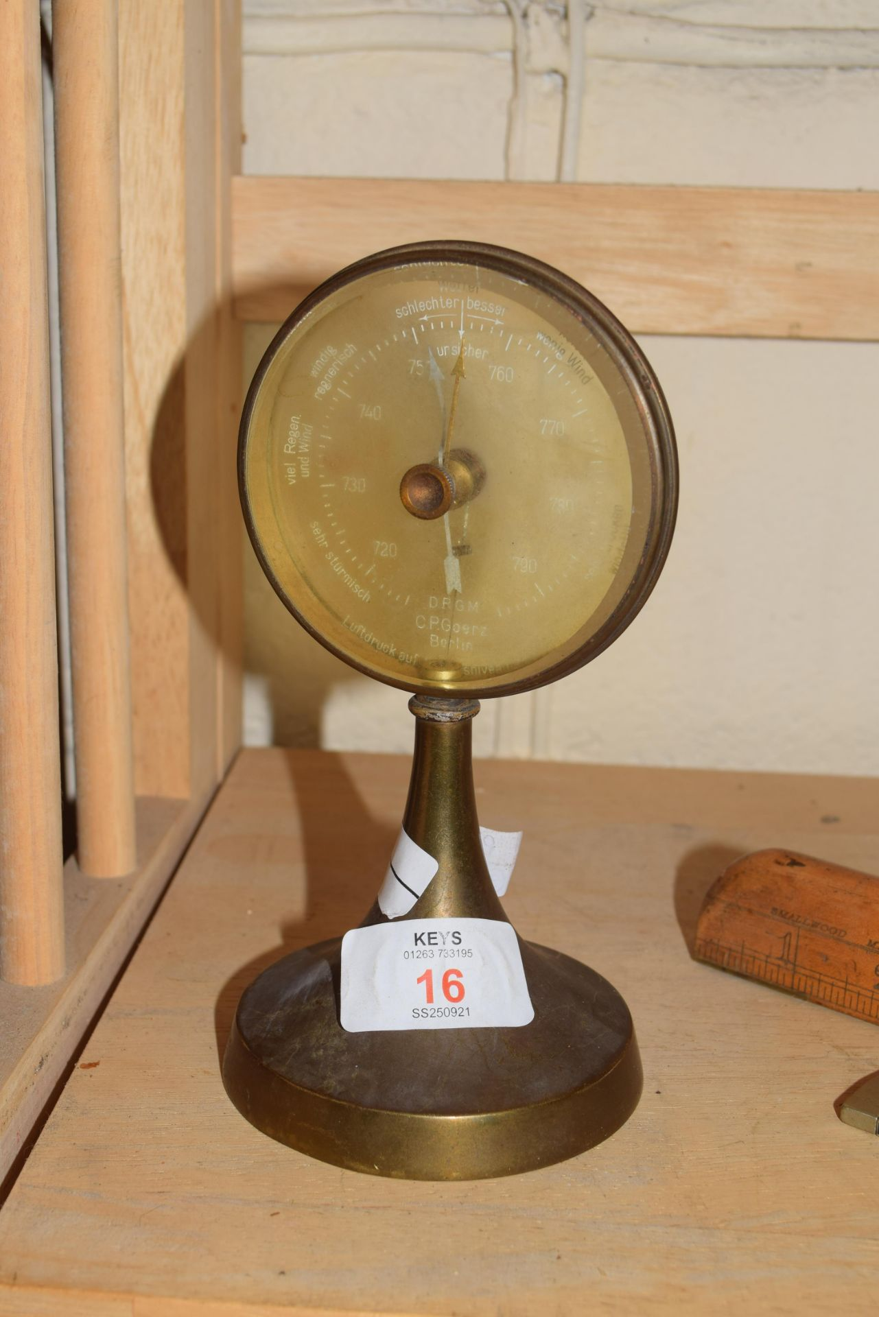 C P Goerz Berlin, early 20th century brass mounted desk barometer, 17cm high