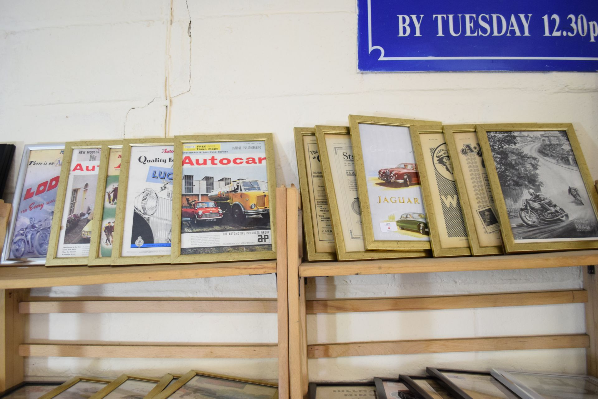 Quantity of framed advertising prints taken from a magazine on motorcycling